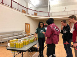 EcoRep Alina talks to students and hands out sustainable goods at Earth Day 2018