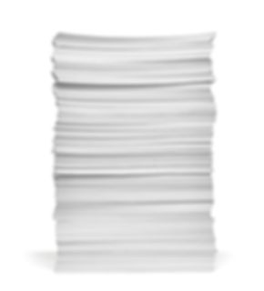 close up of stack of papers on white bac