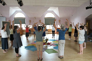 Students in Dancing Hands, Frolicking Voices practice a song