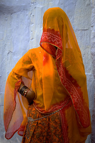 Orange veiled woman