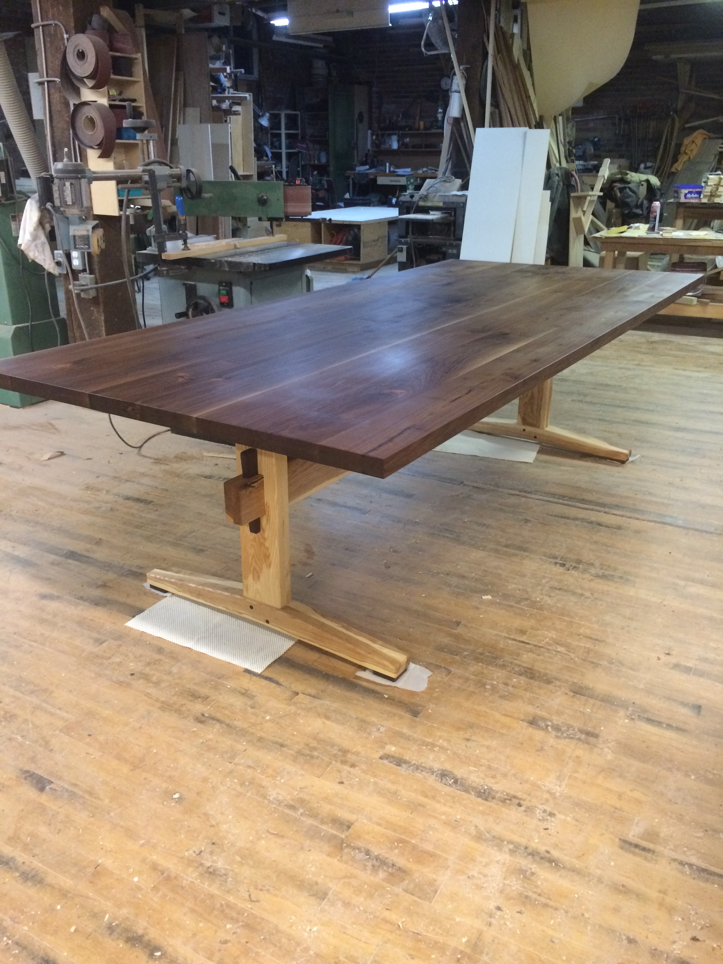 Walnut table on Ash trestle base