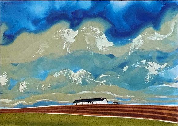 Clouds over Coastguard Cottages