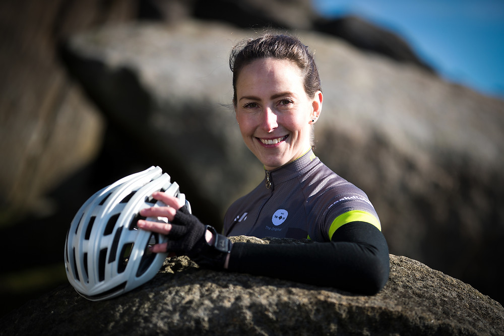 Image of Lorna Fisher holding a bike helmet