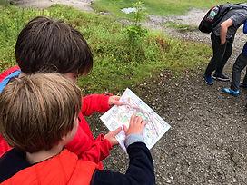 Children reading a map