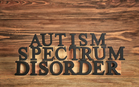 Text AUTISM SPECTRUM DISORDER on wooden