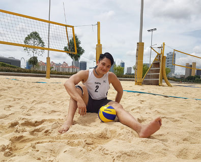 beach vb posing w ball.jpeg