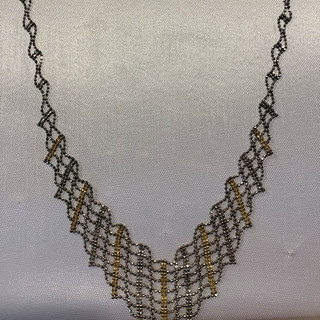 gold and silver necklace.jpg