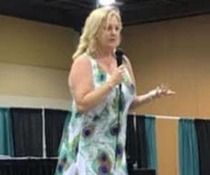 Heidi Speaking on stage.jpg
