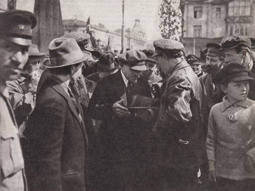 Lenin signs a plaque for the monument to Marx on Sverdlov Square Moscow, May 1 1920