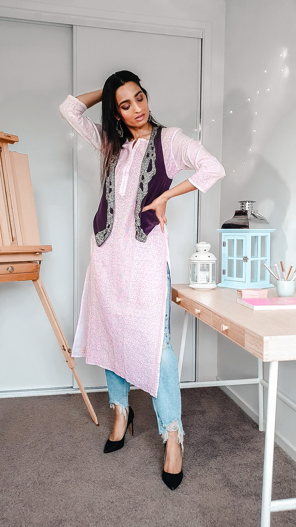 girl blogger at wackyvanilla.com wearing pink chikankari kurta with jeans and embroidered vest to show how to style a kurta in 7 different ways to create indo-western fusion style outfit