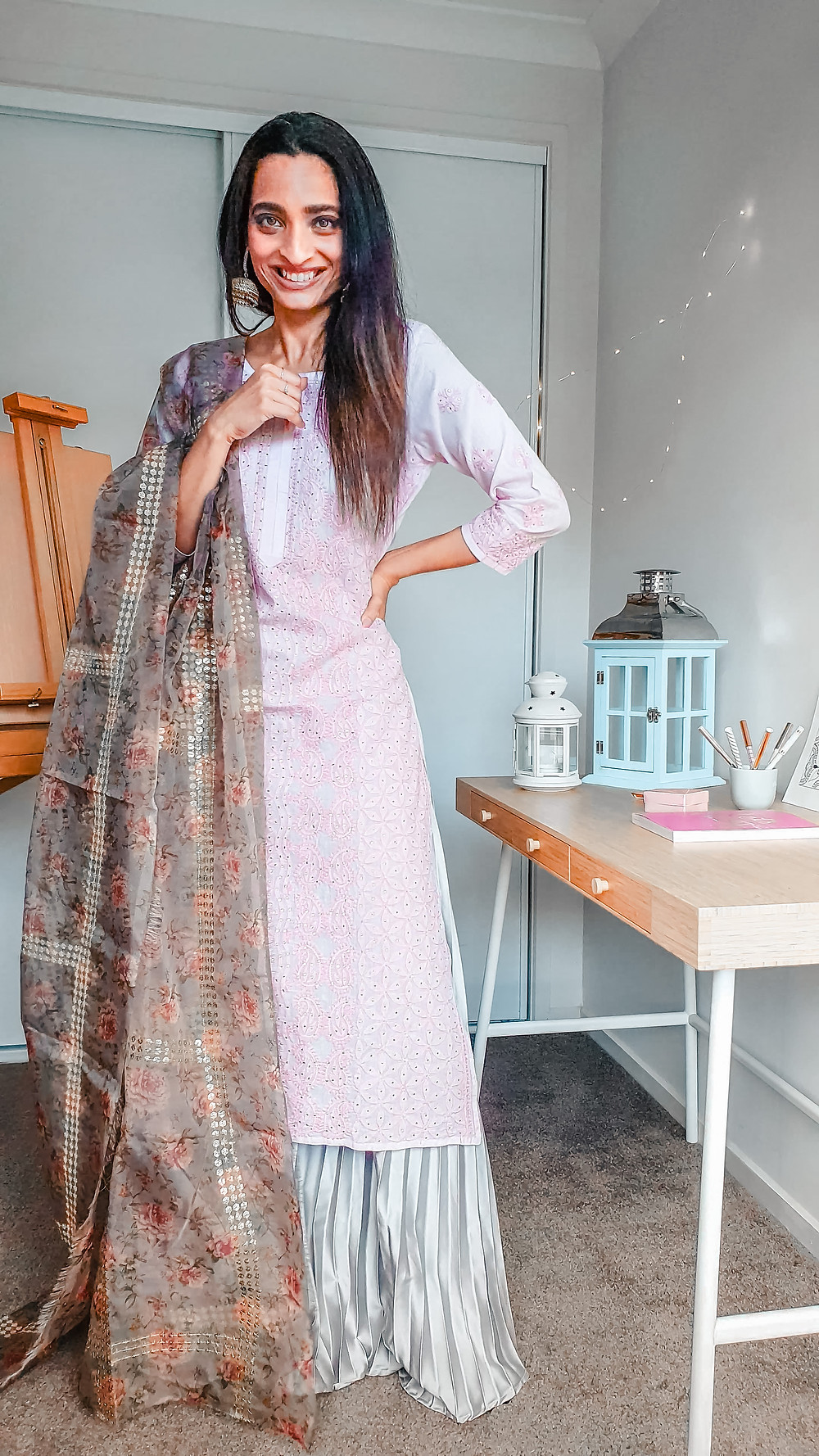 girl blogger at wackyvanilla.com wearing pink chikankari kurta with gray coloured pleated long skirt and printed floral dupatta or drape to show how to style a kurta in 7 different ways to create indo-western fusion style outfit