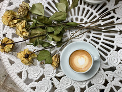 Flat white and dried roses