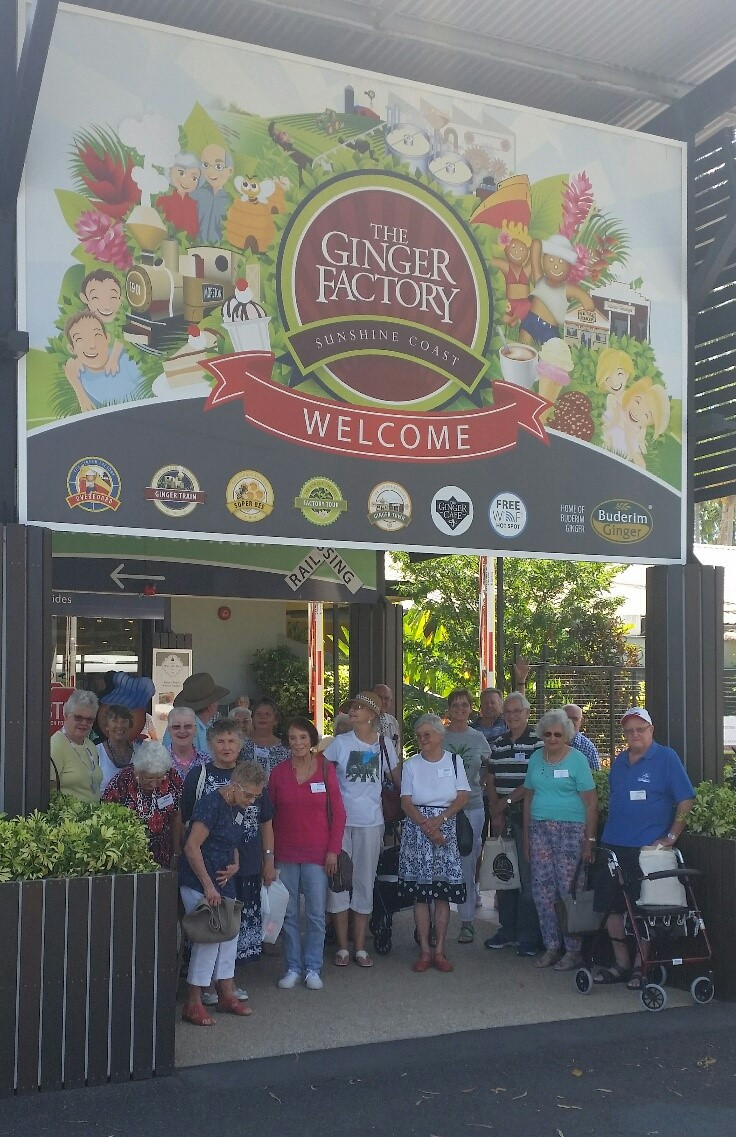 Group photo at entrance to Ginger Factory