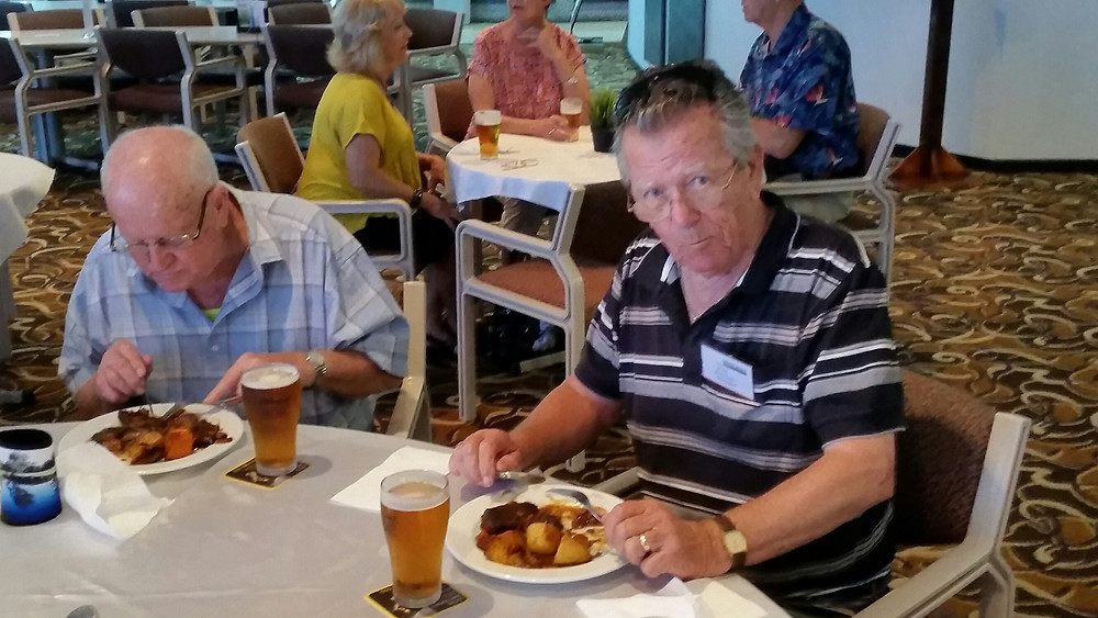 Our President and another member enjoying their liver and bacon.