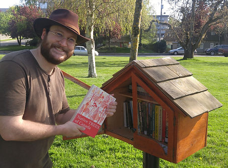 Teale Phelps Bondaroff delivering the 3000th book to a little free library in Rutledge Park, Saanich. Topping up LFLs with books is a small part of the Greater Victoria Placemaking Network's Pocket Places Project, which Teale leads.