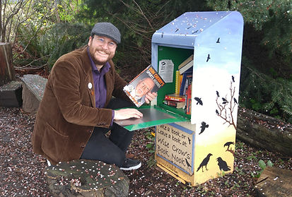 Teale Phelps Bondaroff, delivering a book to a little free library, one of over 4000 he has delivered as part of the Greater Victoria Placemaking Network's Pocket Places Project
