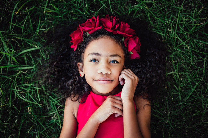 Child portrait drammatic red roses