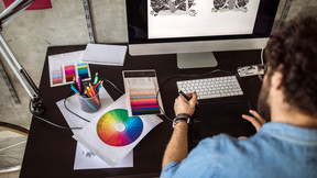 What skills should a Graphic Designer have