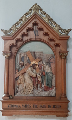 Fifth Station: Simon of Cyrene helps Jesus to carry his cross.
