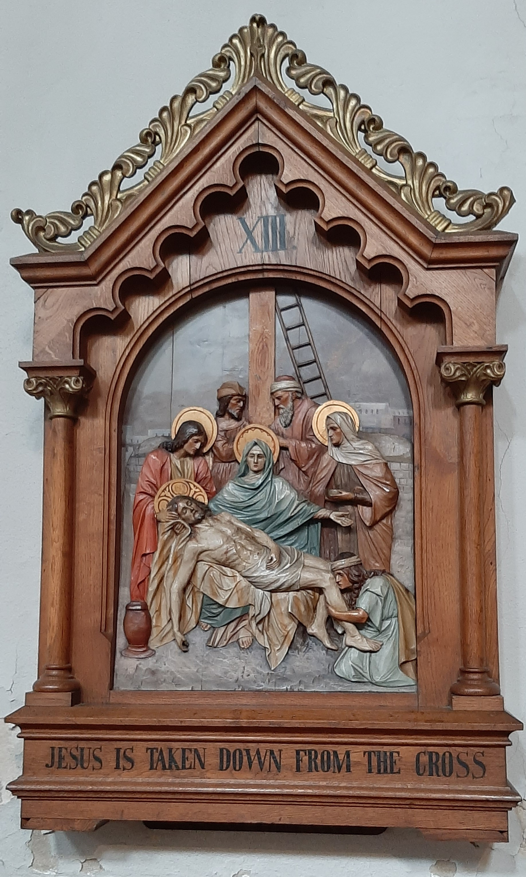 Fourteenth Station: Jesus is laid in the tomb.
