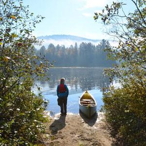 Becky Mason launching canoe