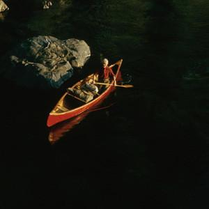 Bill Mason Paddling in Canoe