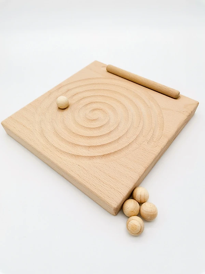 Spiral tracing board and fine motor game.