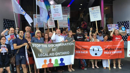 Protest for bargaining rights in front of political event in Toronto.