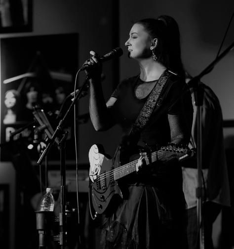 Kelli w guitar bw.png