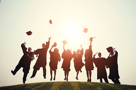Graduates jump in the air, ready for their privately-catered party