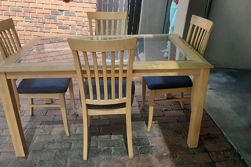 Maple wood dining table and 4 chairs.