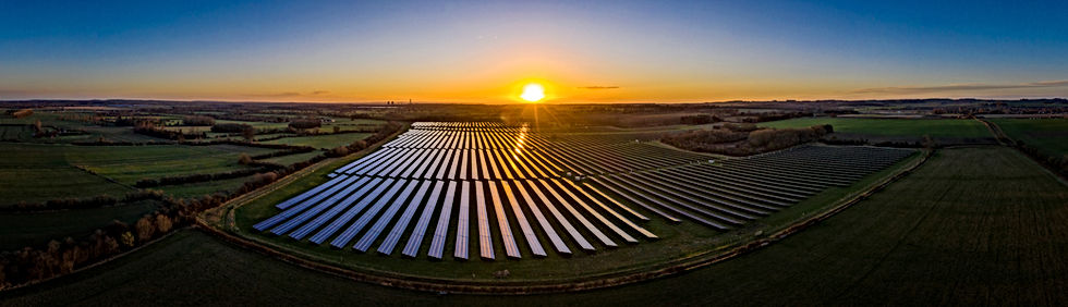 Panoramic of a solar farm at dawn taken