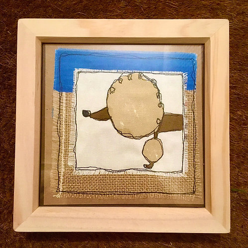 Poodle in pine frame