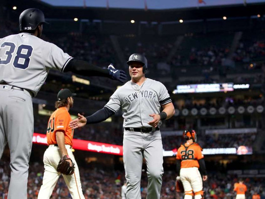 Yankees tally 15 hits in 7-3 victory over Giants