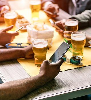 Group-of-People-Beer-Smart-Phones-restaurant-social-media-marketing.jpeg