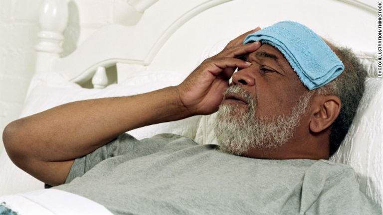 image black man in bed headache.jpg