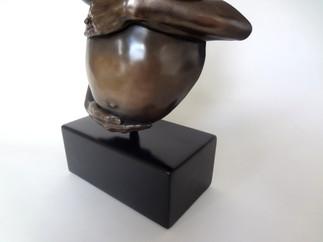 Bronze Patina on a pregnancy bump casting