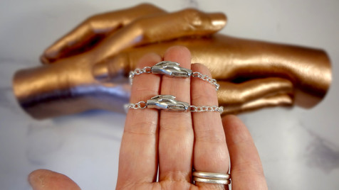 Miniature Sibling Holding Hands Casting into a sterling Silver Pendant