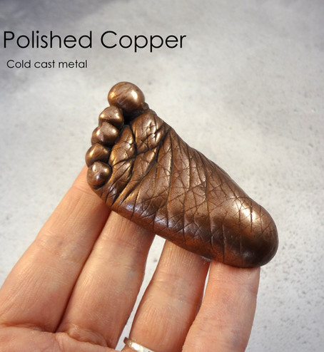 Polished Copper cold cast baby casting by Angelcasts