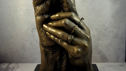 Bronze holding hands casting of father & daughter