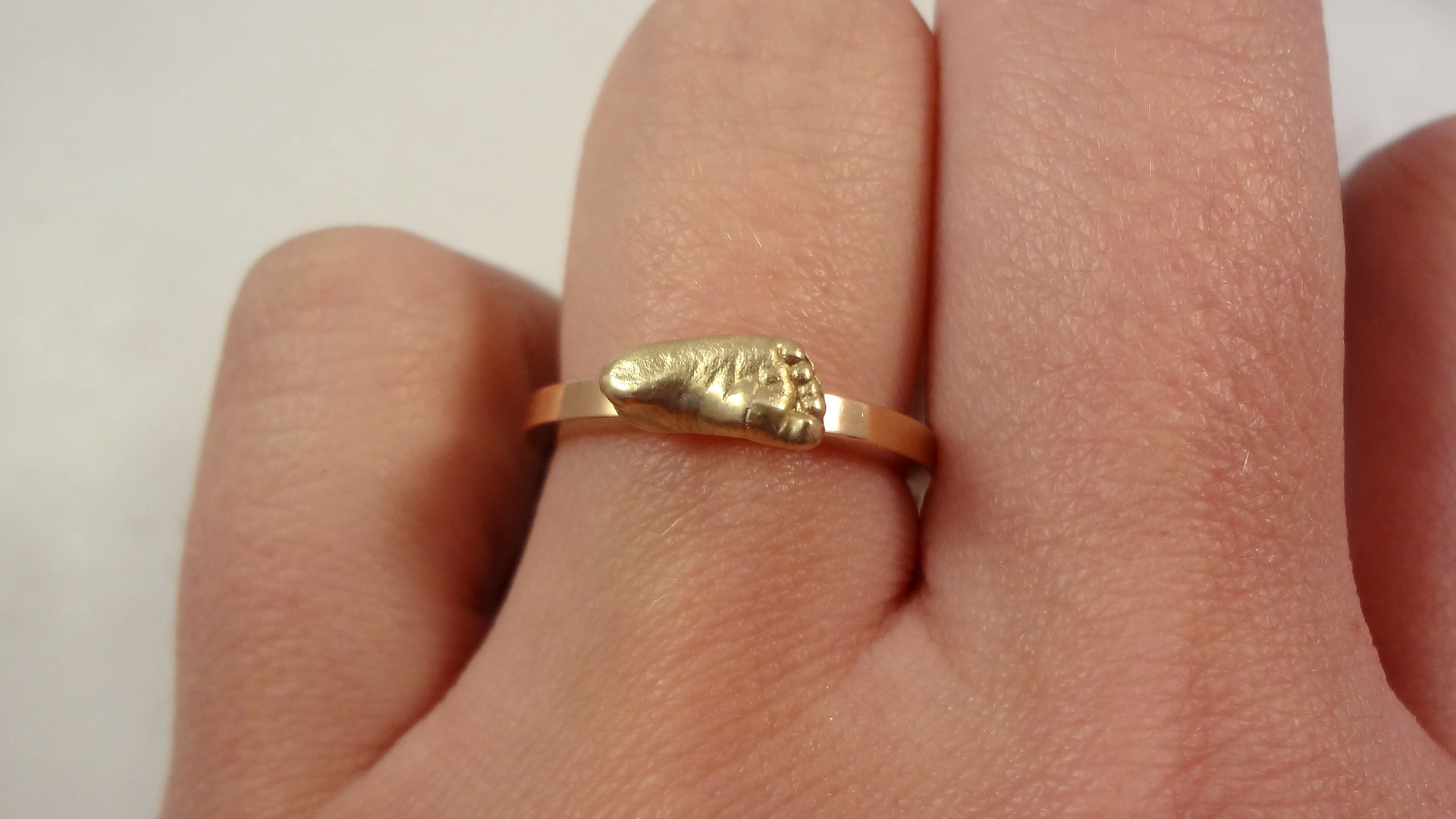 Gold miniature baby cast ring