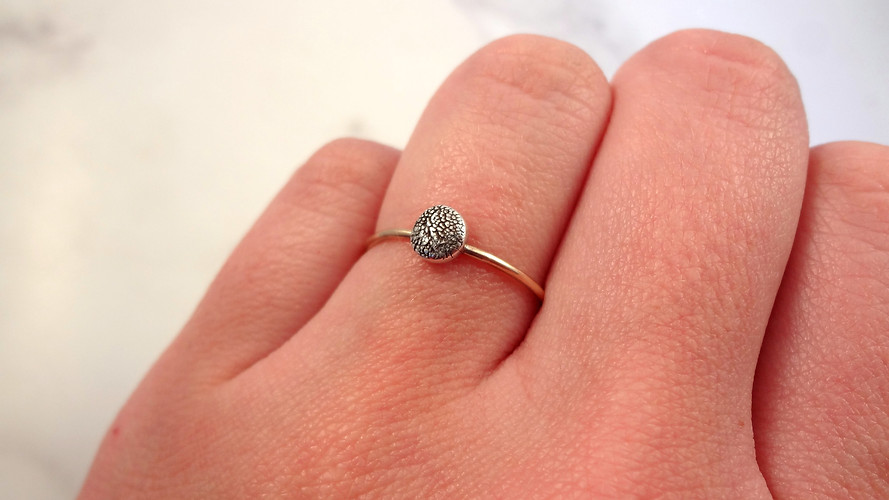 Memorial ring made with a pet paw pad texture