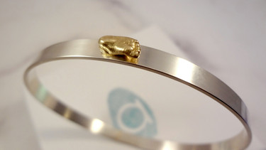 Miniature gold baby cast foot jewellery bangle by Angelcasts in manchester & London