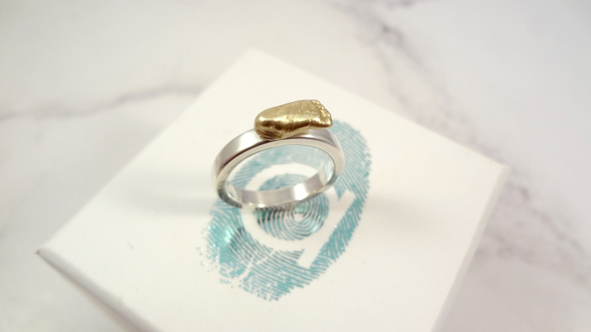 Miniature foot ring in gold & silver