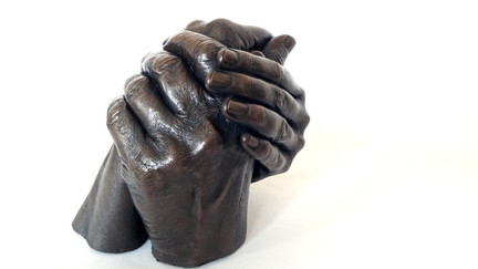 Cold cast bronze metal family holding hands casting in Manchester by Angelcasts