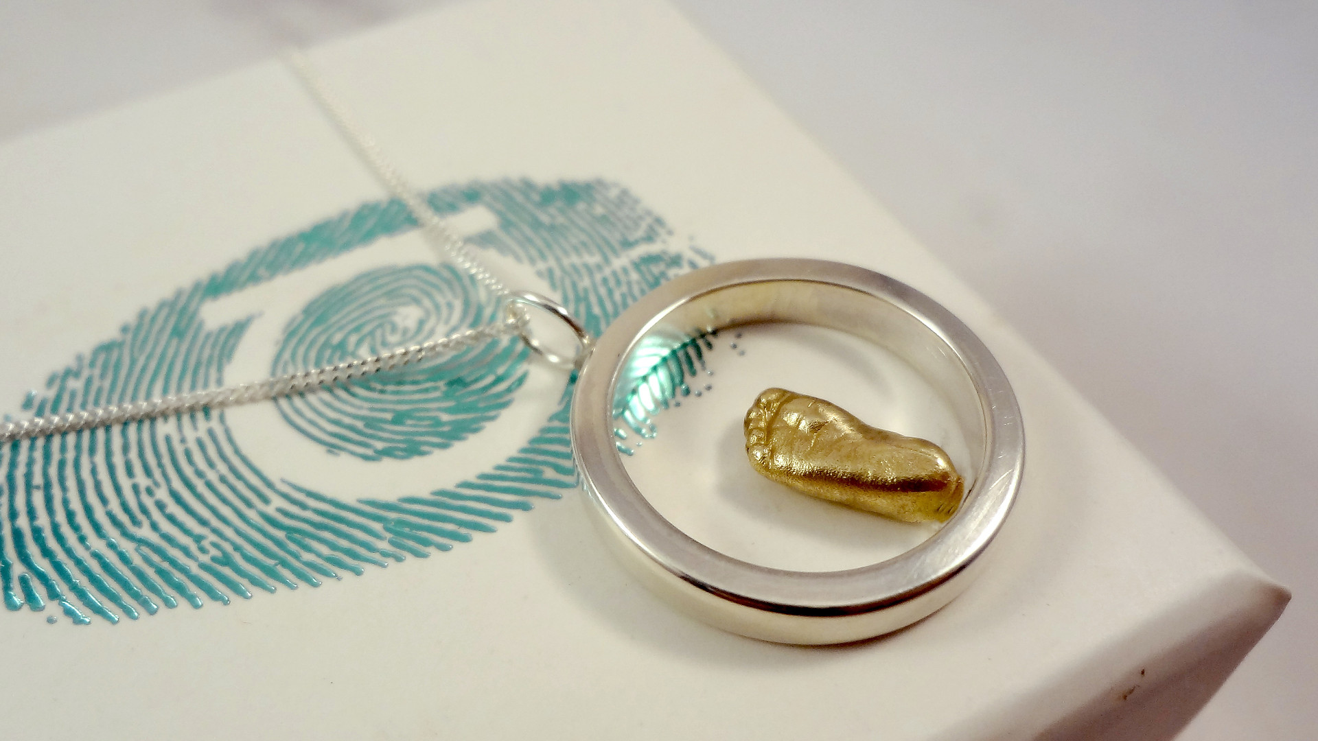 gold eternity pendant for mum & baby