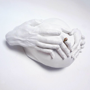 White Fibreglass pregnancy bump with enamel ring detail and partners hands on the bump casting in Manchester