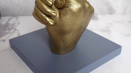 Brass coloured plaster father and daughter hand casting by Angelcasts in London and Manchester