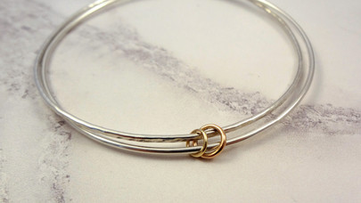 Rose gold & Yellow gold rings on a double bangle set