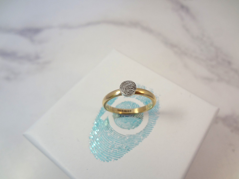 Beautiful curved mini fingerprint ring in gold and silver made by Angelcasts who specialise in discreet contemporary fingerprint jewellery in the UK available overseas with our free fingerprint kits shipped worldwide.